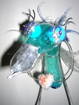 This sculpture is made of plastic, glass, tin and lead. It's on his way to give his heart away to someone he loves..