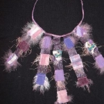 textile collar with feathers