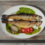 Trout on bed of lettuce