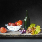 Still life with plums and grape leaf