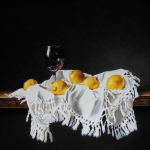 Still life with lemons and wineglass