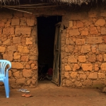 Blue chair against red wall - Angola