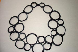bracelets, chains and collars made of rubber.