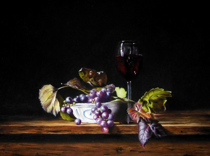 Chinese dish, wine glass and grapes