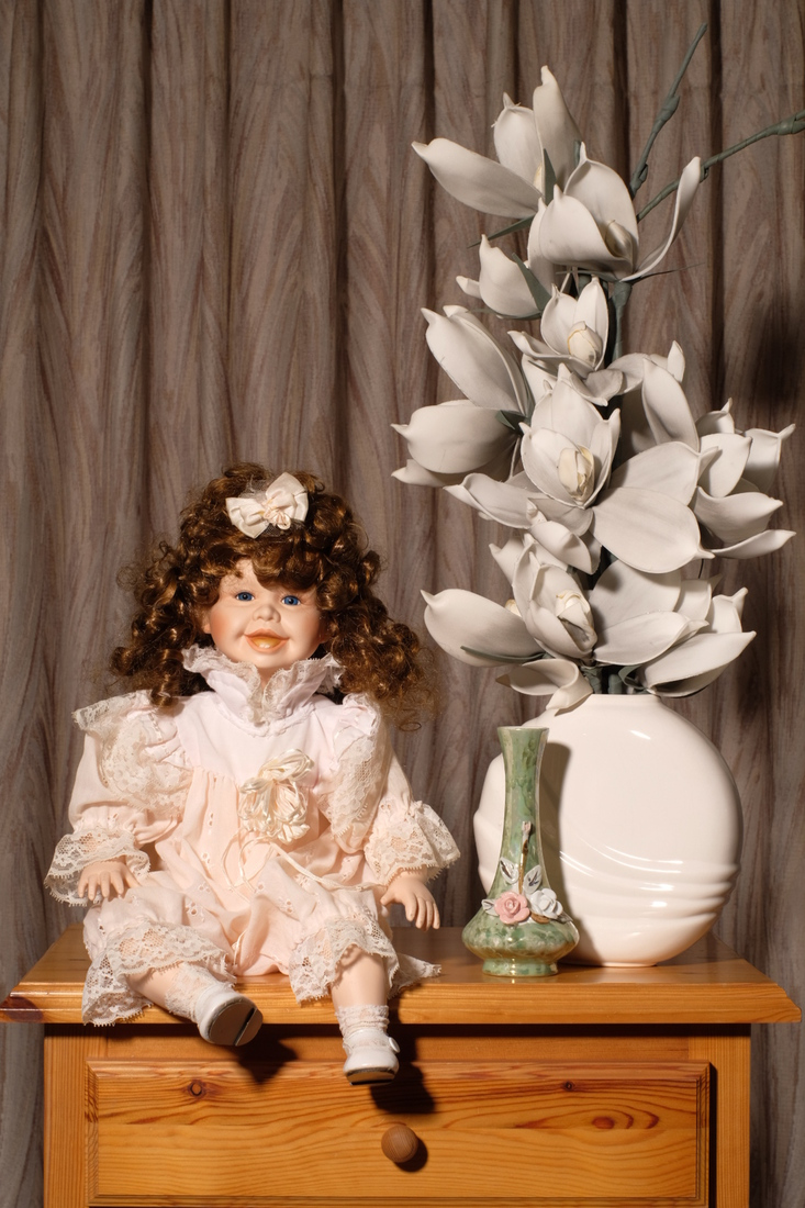 Still life with sitting doll