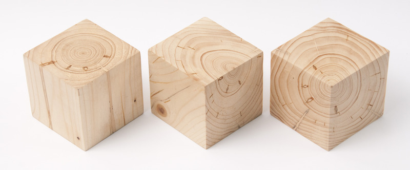 Three equally sized cubes of wood, different sawn
