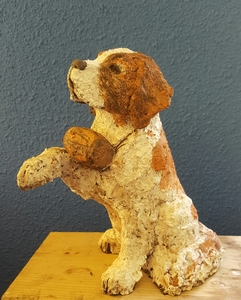 Dogs in clay, coloured with engobes.
